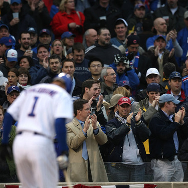 fans looking at fukudome approach first at bat.jpg